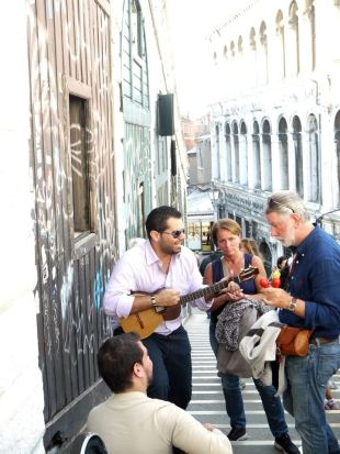 Locals singing on the street, with guitar and maracas venice italy jermpins