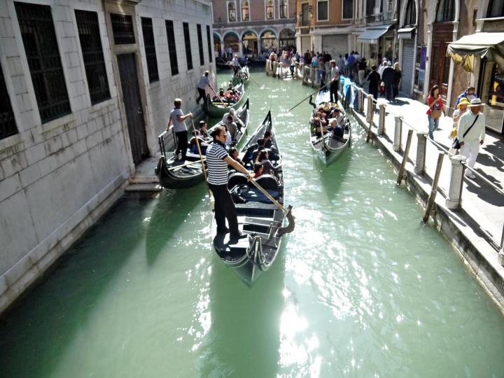 Gondolas in small canals venice italy jermpins